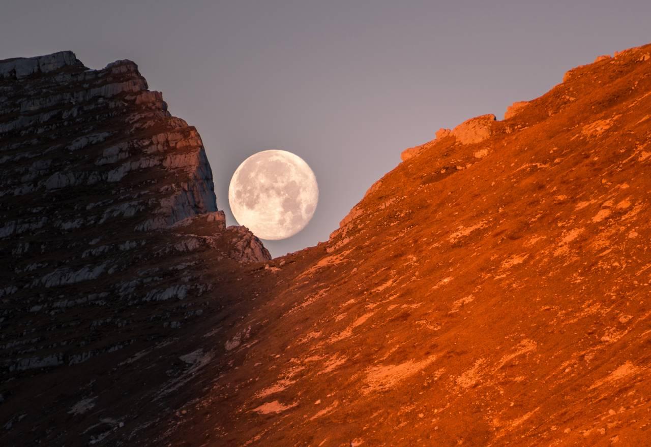 full moon between the hills