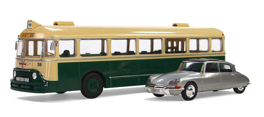 yellow bus silver car