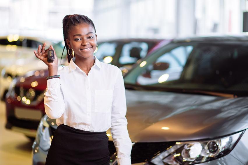 girl smiling showing car keys