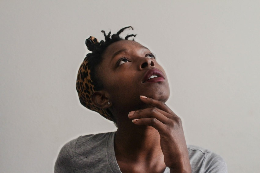 black woman looking up