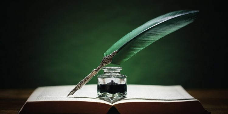 is Jesus God - lying pen of the scribes - Quill pen and inkwell on old book